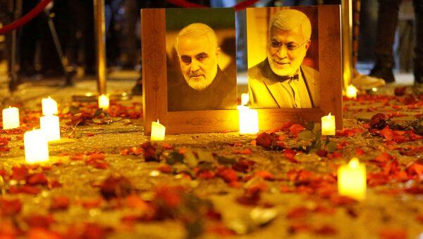 Flowers are laid near pictures of senior Iranian military commander General Qassem Soleimani and Iraqi militia commander Abu Mahdi al-Muhandis on the first anniversary of their killings in a U.S. attack, in Baghdad, Iraq, January 2, 2021.  - Sputnik International