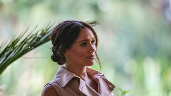 Meghan, the Duchess of Sussex arrives at the British High Commissioner residency where she  will meet with Graca Machel, widow of former South African president Nelson Mandela, in Johannesburg, on October 2, 2019. - Sputnik International