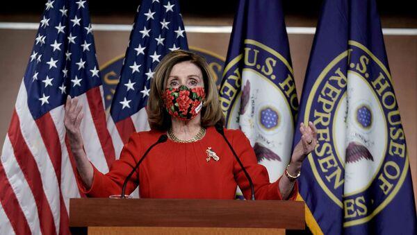 Speaker of the House Nancy Pelosi, D-CA., speaks to reporters on an agreement of a coronavirus disease (COVID-19) aid package on Capitol Hill in Washington, D.C., U.S., December 20, 2020 - Sputnik International