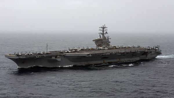 In this Sept. 7, 2020, file photo released by the U.S. Navy, the aircraft carrier USS Nimitz transits the Arabian Sea. The Pentagon announced Thursday, Dec. 31, 2020, that the USS Nimitz, the only Navy aircraft carrier operating in the Middle East, will return home to the U.S. West Coast. - Sputnik International