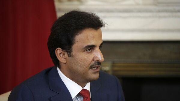 The Emir of Qatar Tamim bin Hamad Al Thani speaks with British Prime Minister Theresa May at the start of their meeting at 10 Downing Street in London, Tuesday, July 24, 2018. - Sputnik International