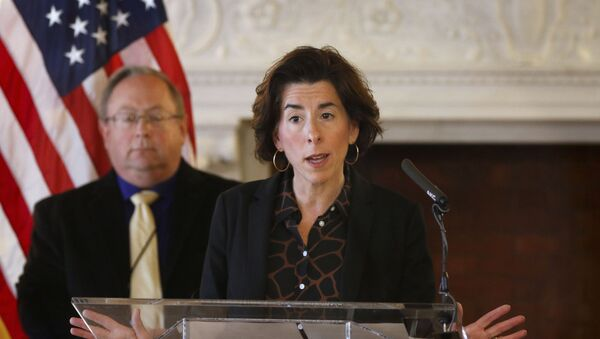 """In this Sunday, March 22, 2020, file photo, Gov. Gina Raimondo gives an update on the coronavirus during a news conference, in Providence, R.I. Many states have yet to spend the federal funding they got to help with soaring costs related to the coronavirus crisis, making it tougher for states and cities to argue that they need hundreds of billions more from U.S. taxpayers. """"If I knew today that another billion dollars was coming to Rhode Island to help solve our budget deficit, I'd spend the $1.25 billion now,"""" Raimondo said about the state's portion of money. """"Lots of other governors are spending. They're taking a gamble, and I'm just not ready to do that yet."""" - Sputnik International"""