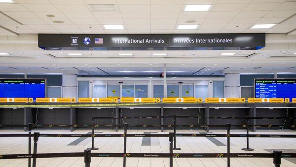 An empty terminal 3, amid a spike in coronavirus disease (COVID-19) cases, at Pearson airport near Toronto, Ontario, Canada December 30, 2020. - Sputnik International