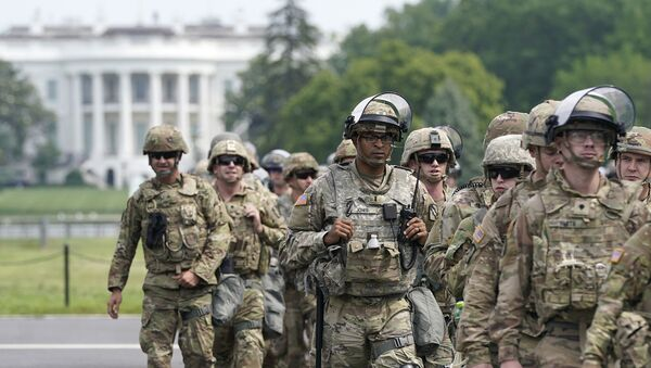 WASHINGTON, DC - JUNE 06: National Guard members deploy near the White House as peaceful protests are scheduled against police brutality and the death of George Floyd, on June 6, 2020 in Washington, DC. People are expected to descend on Washington to participate in peaceful protests in the wake of the death of George Floyd, a black man who was killed in police custody in Minneapolis on May 25.    - Sputnik International