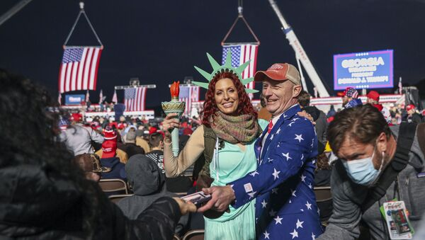 Supporters mingle before a rally with the US president in support of Republican incumbent senators Kelly Loeffler and David Perdue ahead of a Senate runoff in Dalton, Georgia on January 4, 2021. - Sputnik International
