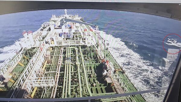 A CCTV footage of the Hankuk Chemi, a South Korean-flagged oil tanker, is displayed on a screen as a boat of Iran's Revolutionary Guards is seen in red circle on the screen at the tanker's owner company DM Shipping, in Busan on January 4, 2021. - South Korea's foreign ministry on January 4 demanded the early release of an oil tanker seized by Iran in Gulf waters for breaking maritime environmental laws. (Photo by - / YONHAP / AFP) / - South Korea OUT / REPUBLIC OF KOREA OUT  NO ARCHIVES  RESTRICTED TO SUBSCRIPTION USE - Sputnik International