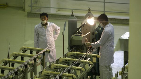 In this April 9, 2009 file picture Iranian technicians work  at a new facility producing uranium fuel for a planned heavy-water nuclear reactor, just outside the city of Isfahan, 255 miles (410 kilometers) south of the capital Tehran. Iran is lagging behind on equipping a bunker with machines enriching uranium to a grade that can be turned quickly to arm nuclear warheads and now says will produce less at the site than originally planned, diplomats tell The Associated Press.   - Sputnik International