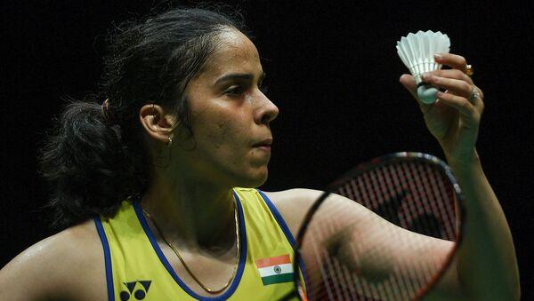 India's Saina Nehwal serves against Spain's Carolina Marin during their women singles quarter-final match at the Malaysia Open badminton tournament in Kuala Lumpur on January 10, 2020. - Sputnik International