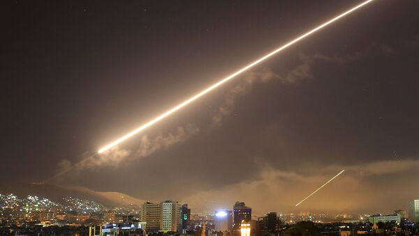 In this April 14, 2018 file photo, Damascus skies erupt with surface to air missile fire as the U.S. launches an attack on Syria targeting different parts of the Syrian capital Damascus, Syria. - Sputnik International