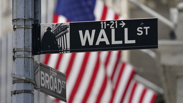 In this Nov. 23, 2020, photo, a street sign is displayed at the New York Stock Exchange in New York. S&P DJ Indices is removing 21 Chinese companies from its indexes, or groups of stocks and bonds used to track financial market movements, after Americans were barred from investing in them as part of a feud with Beijing over technology and security. - Sputnik International