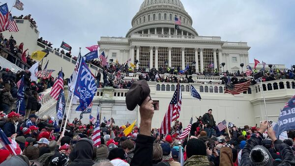 Demonstrators protest outside US Capitol Building in Washington to contest the certification of the 2020 presidential election results by the US Congress, 6 January 2021 - Sputnik International