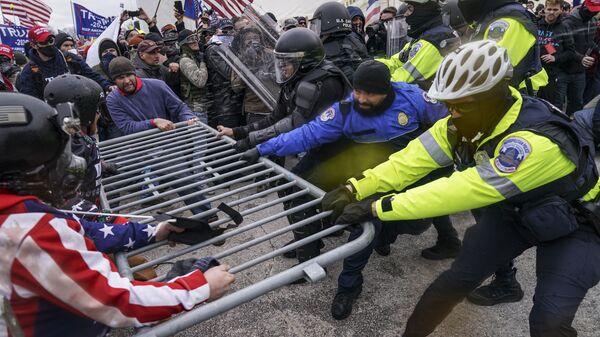 Trump supporters try to break through a police barrier, Wednesday, Jan. 6, 2021, at the Capitol in Washington - Sputnik International