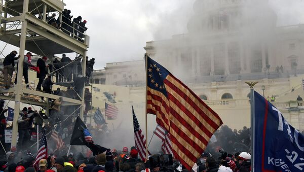 Supporters of US President Donald Trump protest in front of the U.S. Capitol Building in Washington, DC, 6 January 2021. - Sputnik International