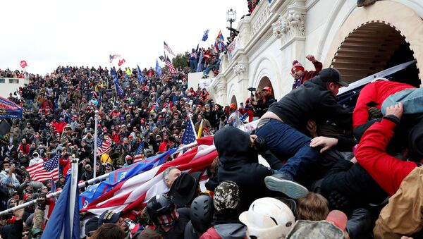 Pro-Trump protesters storm into the US Capitol during clashes with police, during a rally to contest the certification of the 2020 US presidential election results by the US Congress, in Washington, US, 6 January 2021 - Sputnik International