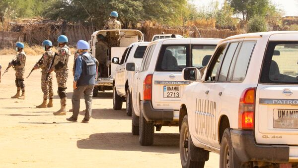 Members of the United Nations and African Union peacekeeping mission (UNAMID) gather with their vehicles in Kalma camp for internally displaced people in Nyala, the capital of South Darfur, on December 31, 2020. - Sputnik International