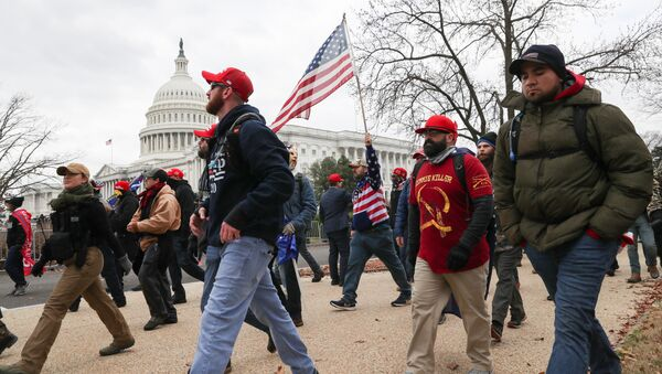 Members of the the far-right group Proud Boys march to the U.S. Capitol Building in Washington, U.S., January 6, 2021. - Sputnik International