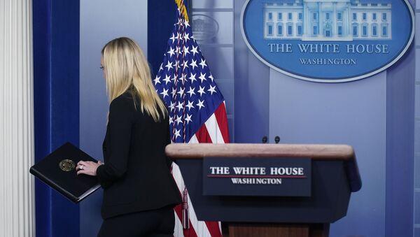 White House press secretary Kayleigh McEnany departs after delivering a statement at the White House, Thursday, Jan. 7, 2021, in Washington. (AP Photo/Patrick Semansky) - Sputnik International