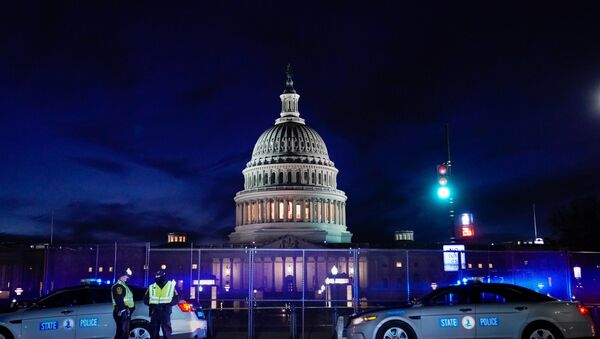 The U.S. Capitol is seen behind heavy-duty security fencing the day after supporters of U.S. President Donald Trump stormed the Capitol in Washington, U.S., January 7, 2021. - Sputnik International