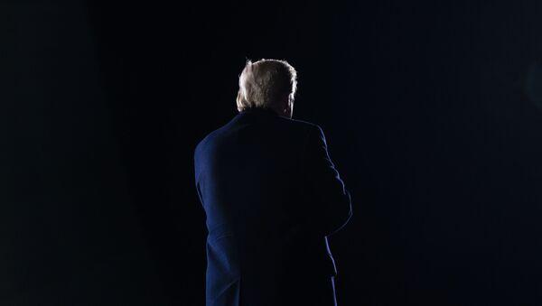 President Donald Trump walks off stage after speaking during a campaign rally for Sen. Kelly Loeffler, R-Ga., and Sen. David Perdue, R-Ga., at Dalton Regional Airport, Monday, Jan. 4, 2021, in Dalton, Ga. - Sputnik International
