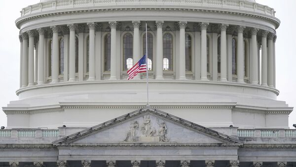 An American flag flies at half-staff in remembrance of U.S. Capitol Police Officer Brian Sicknick above the Capitol Building in Washington, Friday, Jan. 8, 2021 - Sputnik International