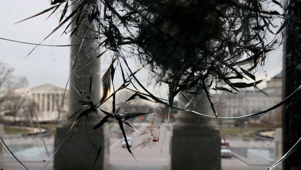 Riot damage is visible on the Rotunda doors of the U.S. Capitol in Washington, U.S. January 8, 2021. - Sputnik International