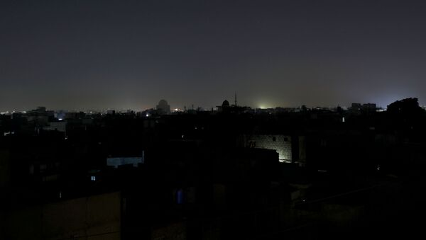 A general view of a residential area is seen during a power breakdown in Karachi, Pakistan, January 10, 2021. - Sputnik International