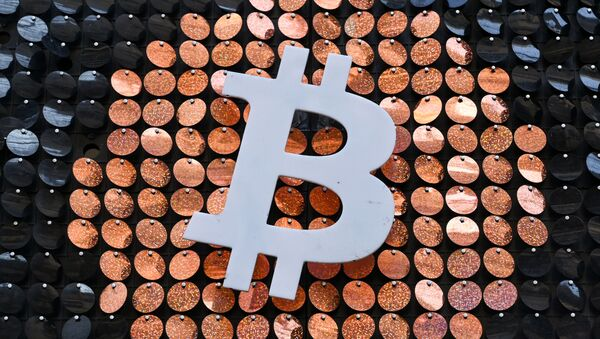 The logo of Bitcoin digital currency is pictured on the front door of an ATM in Marseille, southern France, on January 8, 2021. - Sputnik International