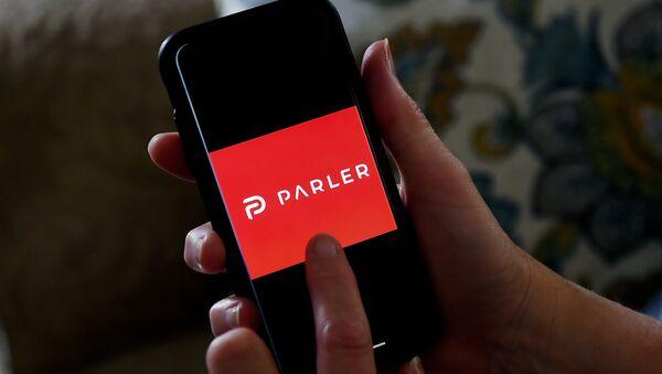 This illustration file photo taken on July 2, 2020 shows social media application logo Parler displayed on a smartphone in Arlington, Virginia. - Sputnik International