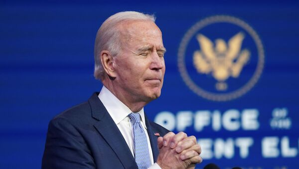 U.S. President-elect Joe Biden clasps his hands in prayer as he speaks about the violent protests in and around the U.S. Capitol in Washington, which forced members of Congress to suspend a joint session to certify the 2020 election results, during brief remarks at Biden's transition headquarters in Wilmington, Delaware, U.S., January 6, 2021. REUTERS/Kevin Lamarque - Sputnik International