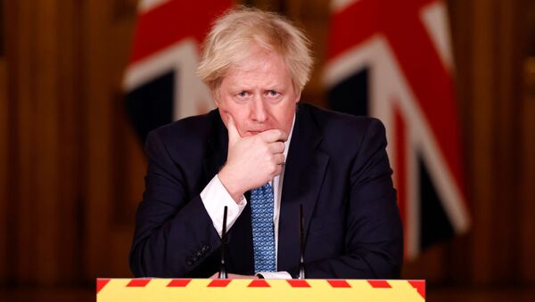 Britain's Prime Minister Boris Johnson reacts during a virtual news conference on the COVID-19 pandemic, at 10 Downing Street in London, Britain January 7, 2021 - Sputnik International
