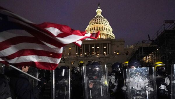 Police stand guard after a day of riots at the U.S. Capitol in Washington on Wednesday, Jan. 6, 2021 - Sputnik International