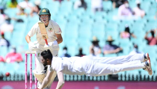Marnus Labuschagne of Australia looks on as Mohammed Siraj of India dives for the ball during day four of the third test match between Australia and India at the SCG, Sydney, Australia, January 10, 2021 - Sputnik International
