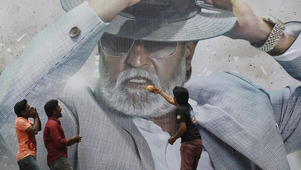 """Fans of Indian superstar Rajinikanth offer prayers in front of his poster outside a cinema hall to celebrate the screening of """"Kabali"""" in Chennai, India, Friday, July 22, 2016 - Sputnik International"""
