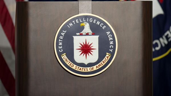 The lectern with CIA logo stands empty as reporters await the arrival of Director of Central Intelligence Agency John Brennan for a press conference at CIA headquarters in Langley, Virginia, December 11, 2014. - Sputnik International