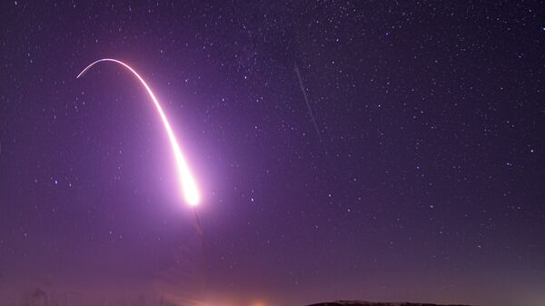 This image taken with a slow shutter speed on Oct. 2, 2019, and provided by the U.S. Air Force shows an unarmed Minuteman 3 intercontinental ballistic missile test launch at Vandenberg Air Force Base, Calif. The Pentagon has raised to $95.8 billion the estimated cost of fielding a new fleet of land-based nuclear missiles to replace the Minuteman 3 - Sputnik International
