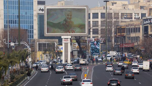 A photo of senior Iranian military commander General Qassem Soleimani, is seen on a city giant screen on a street during the one year anniversary of his killing in a U.S. attack, in Tehran, Iran January 1, 2021. - Sputnik International