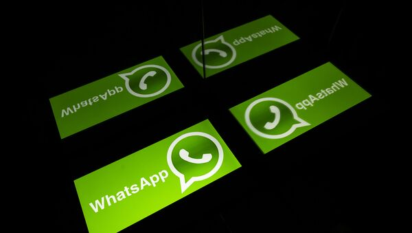 (FILES) This file photo taken on October 5, 2020 shows the logo of mobile messaging service WhatsApp on a tablet screen in Toulouse, southwestern France - Sputnik International