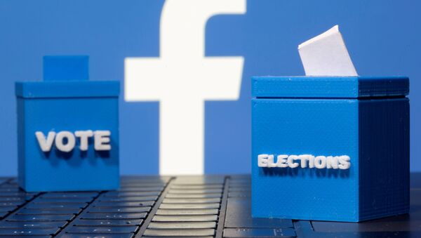 3D printed ballot boxes are seen in front of a displayed Facebook logo in this illustration taken November 4, 2020. REUTERS/Dado Ruvic/Illustration/File Photo - Sputnik International