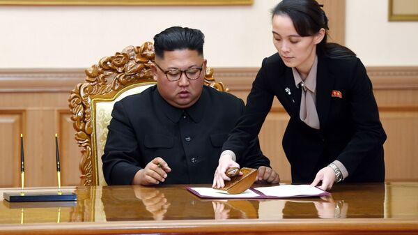 In this Sept. 19, 2018, file photo, Kim Yo Jong, right, sister of North Korean leader Kim Jong Un, helps Kim sign joint statement following the summit with South Korean President Moon Jae-in at the Paekhwawon State Guesthouse in Pyongyang, North Korea. Kim's prolonged public absence has led to rumors of ill health and worries about how it could influence the future of what one analyst calls Northeast Asia's Achilles' heel, a reference to the North's belligerence and unpredictable nature. - Sputnik International