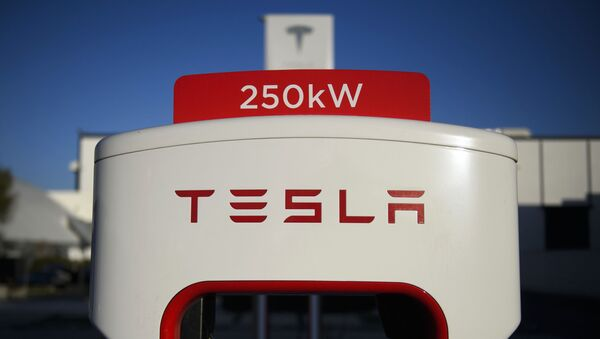 (FILES) In this file photo a Tesla logo is seen on a 250kW electric vehicle charging station at the Tesla Inc. supercharger station on January 4, 2021 in Hawthorne, California. - Sputnik International