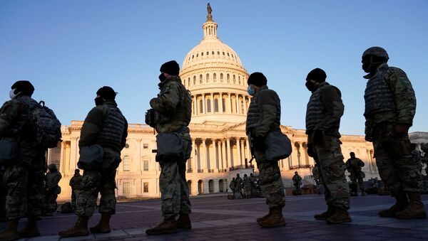 Members of the National Guard are given weapons before Democrats begin debating one article of impeachment against U.S. President Donald Trump at the U.S. Capitol, in Washington, U.S., January 13, 2021 - Sputnik International