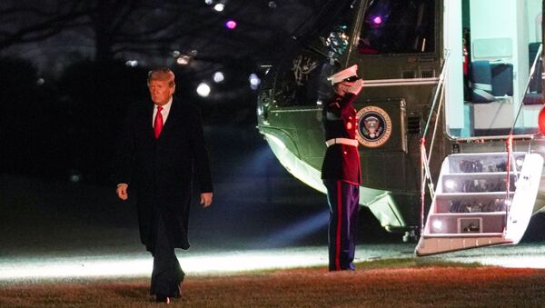 U.S. President Donald Trump walks from Marine One upon his return to the White House in Washington, U.S., January 12, 2021.   - Sputnik International