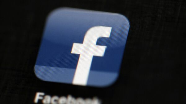 In this May 16, 2012, file photo, the Facebook logo is displayed on a mobile device in Philadelphia - Sputnik International