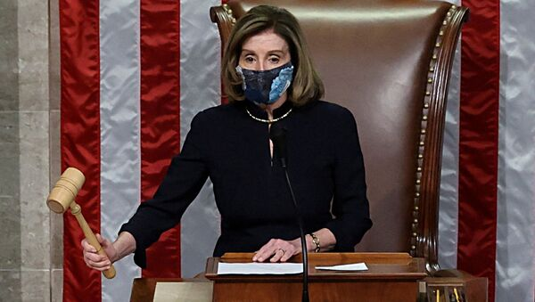 US House Speaker Nancy Pelosi (D-CA) presides over the vote to impeach President Donald Trump for a second time, a week after his supporters stormed the Capitol building, on the floor of the House of Representatives in Washington 13 January 2021.  - Sputnik International