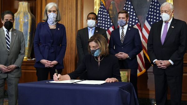 House Speaker Nancy Pelosi of Calif., signs the article of impeachment against President Donald Trump in an engrossment ceremony before transmission to the Senate for trial on Capitol Hill, in Washington, Wednesday, Jan. 13, 2021.  - Sputnik International