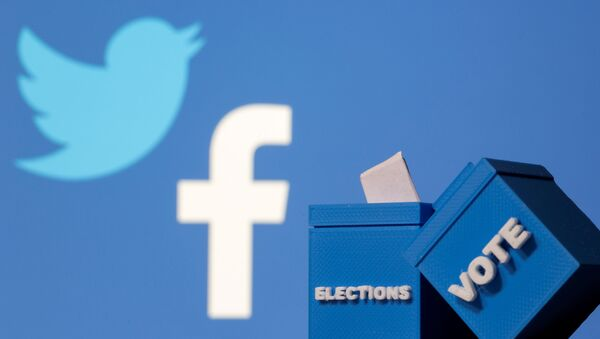 3D-printed ballot boxes are seen in front of displayed Facebook and Twitter logos in this illustration taken November 4, 2020 - Sputnik International
