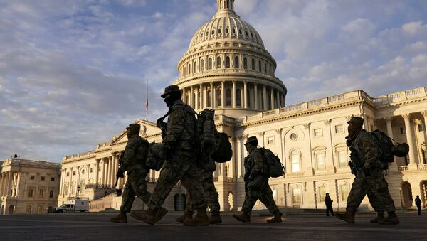 National Guard members walk in front of the U.S. Capitol after the House voted to impeach U.S. President Donald Trump in Washington, U.S., January 14, 2021 - Sputnik International