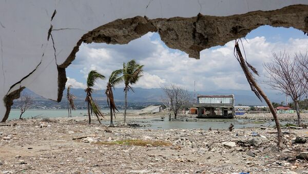 Ruins and damaged building are pictured nearly one year after an earthquake and tsunami at a beach in Palu, Central Sulawesi, Indonesia - Sputnik International