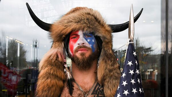 Jacob Anthony Chansley, also known as Jake Angeli, of Arizona, poses with his face painted in the colors of the U.S. flag as supporters of U.S. President Donald Trump gather in Washington, U.S. January 6, 2021 - Sputnik International