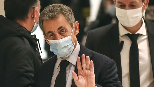 Former French President Nicolas Sarkozy waves to the media as he arrives at the courtroom in Paris, Friday, Dec. 10, 2020 - Sputnik International